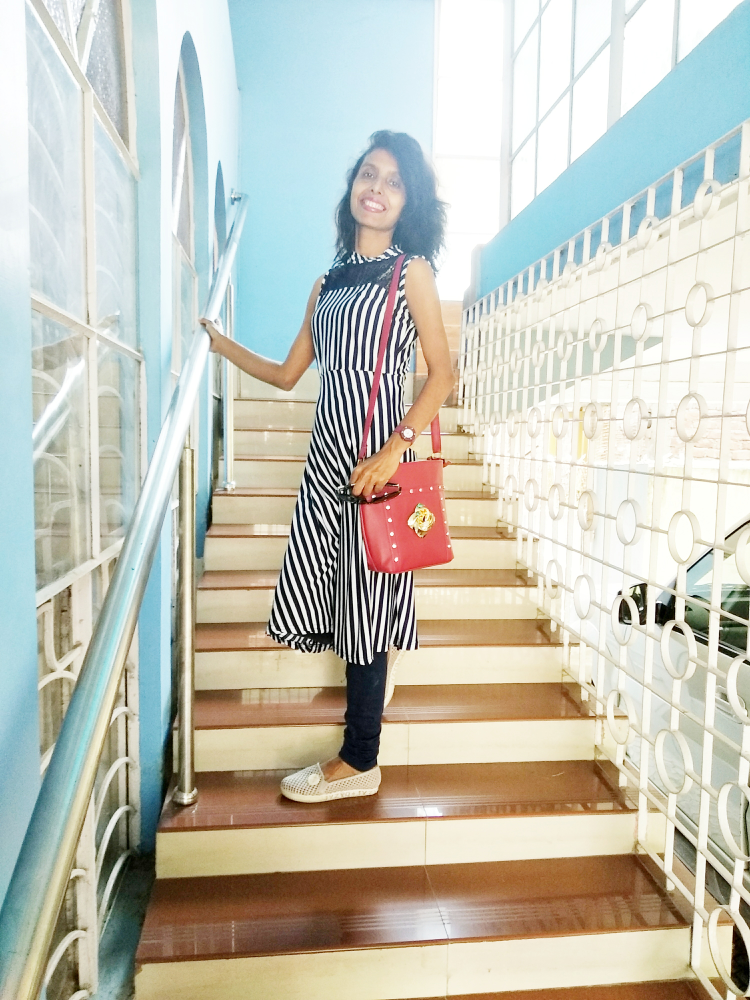 A style with a stripe outfit image