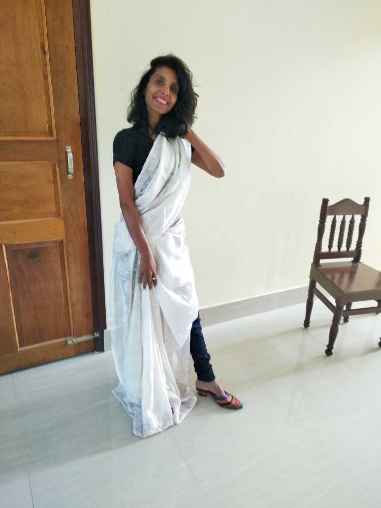 A unique style by draping a saree over a pair of jeans image